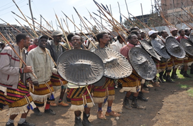 The Sidama men with shield and sword celebrating Fichee Chembelala